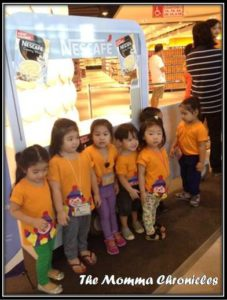 A and her classmates waiting outside the supermarket